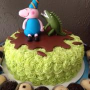 O bolo do George com o dinossauro da Luana Davidsohn
